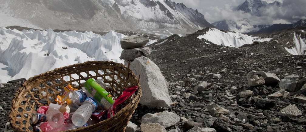 Rubbish collected at Everest base camp with the Himalayan range seen at the background in Nepal, May 03, 2011. Picture taken May 03, 2011. REUTERS/Laurence Tan (NEPAL - Tags: TRAVEL SOCIETY) - GM1E75P1OV001