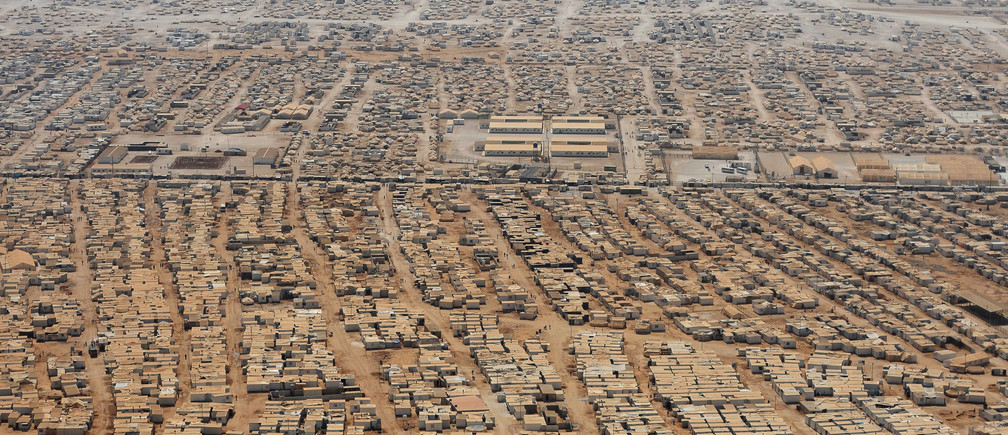 An aerial view shows the Zaatari refugee camp, near the Jordanian city of Mafraq July 18, 2013. U.S. Secretary of State John Kerry spent about 40 minutes with half a dozen refugees who vented their frustration at the international community's failure to end Syria's more than two-year-old civil war, while visiting the camp that holds roughly 115,000 Syrian refugees in Jordan about 12 km (eight miles) from the Syrian border. REUTERS/Mandel Ngan/Pool (JORDAN - Tags: POLITICS SOCIETY IMMIGRATION TPX IMAGES OF THE DAY) - RTX11QHF