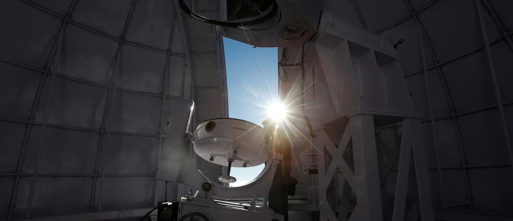 Sunlight beams through the dome of the solar tunnel telescope at the Kodaikanal Solar Observatory, India, February 3, 2017.