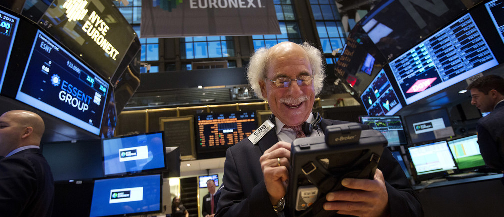 Trader Peter Tuchman smiles as he works on the floor of the New York Stock Exchange.