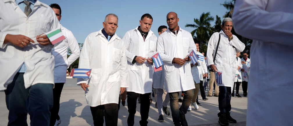 Cuban doctors take part in a farewell ceremony before departing to Italy to assist, amid concerns about the spread of the coronavirus disease (COVID-19) outbreak, in Havana, Cuba, March 21, 2020. REUTERS/Alexandre Meneghini