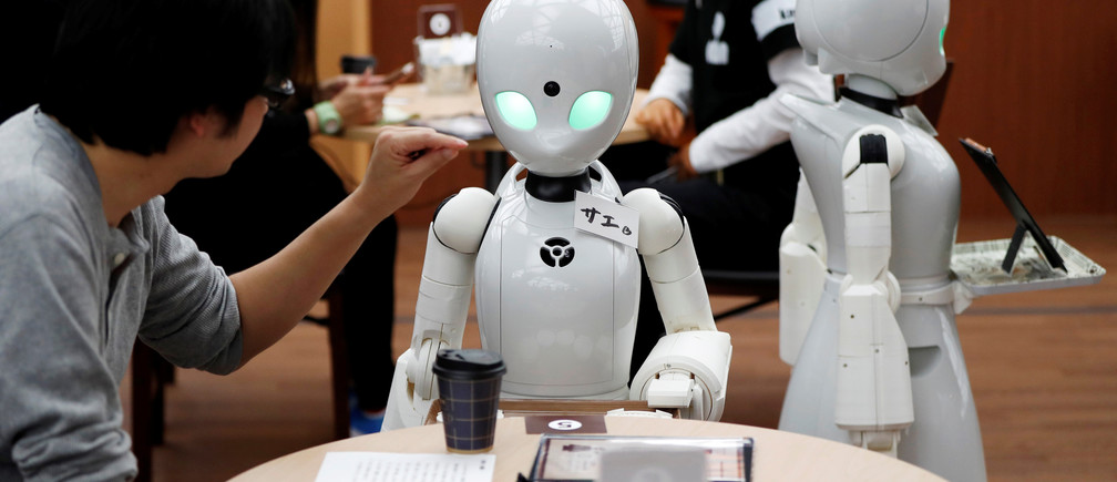 Remotely controlled robots OriHime-D, developed by Ory Lab Inc. to promote employment of disabled people, serve customers at a cafe in Tokyo, Japan November 26, 2018.  REUTERS/Issei Kato - RC142F1E7620