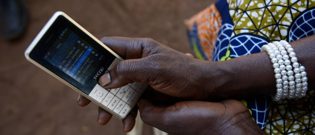 sther Nakisige, a beneficiary of the MUIIS farmer information service, checks her phone at her home in Iganga District, Uganda, on February 14, 2019. Thomson Reuters Foundation/Stringer