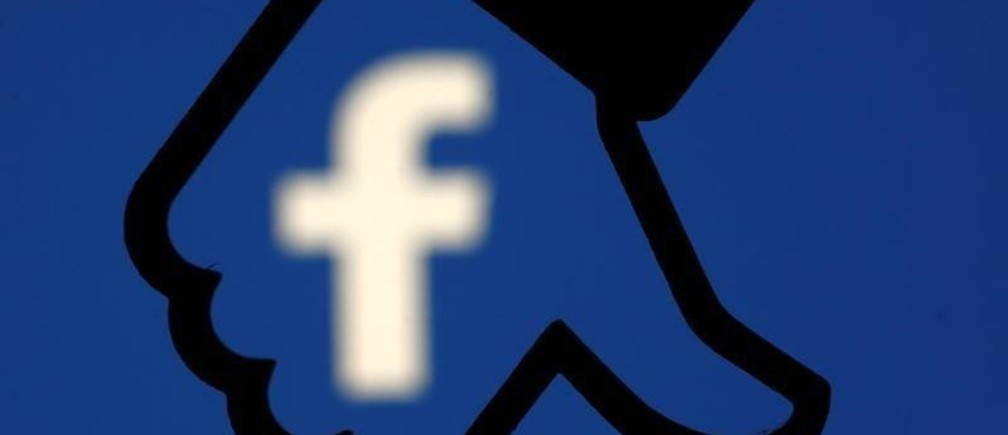 A 3D-printed Facebook dislike button is seen in front the Facebook logo, in this illustration taken October 25, 2017. REUTERS/Dado Ruvic/Illustration - RC193B7FA2E0