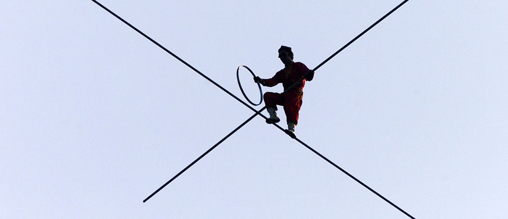 Highwire walker Aisikaier, from the far-western Chinese region ofXinjiang, performs on a wire about 110 metre above the Great Wall nearBeijing, September 16, 2002. Three Chinese tightrope walkers areperforming daily on the 1,004-metre-long wire over the Great Wall untilSeptember 22 as part of a cultural festival marking China's traditionalMid-Autumn Festival, which falls on September 21 this year.REUTERS/Wilson ChuASW/RCS - RP3DRIEEXCAA