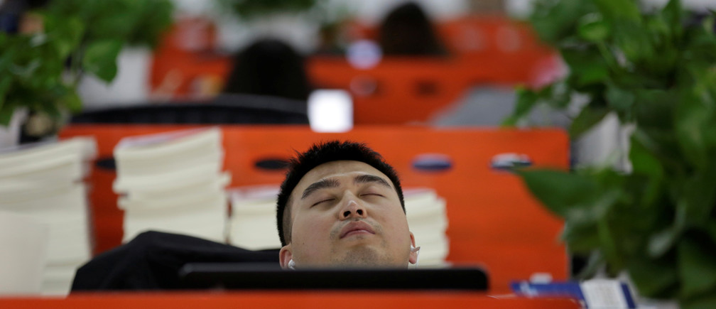"Cui Meng, a Co-founder of Goopal Group, takes a nap in his seat after lunch, in Beijing, China, April 21, 2016. Office workers sleeping on the job is a common sight in China, where a surplus of cheap labour can lead to downtime at work. But in China's technology sector, where business is growing faster than many start-up firms can hire new staff, workers burn the midnight oil to meet deadlines and compete with their rivals. Some companies provide sleeping areas and beds for workers to rest during late nights. REUTERS/Jason Lee       SEARCH ""JASON SLEEP"" FOR THIS STORY. SEARCH ""THE WIDER IMAGE"" FOR ALL STORIES   - S1BETDIDHOAD"