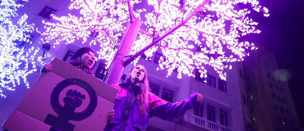 Demonstrators hold a placard during a protest to mark the annual International Day for the Elimination of Violence against Women in Madrid, Spain, November 25, 2019. REUTERS/Sergio Perez - RC2KID9UL2RB