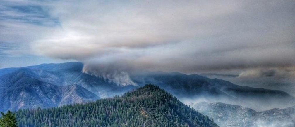 FILE PHOTO: Smoke rises near Pinoche Peak on the east flank of the Ferguson Fire looking towards Chowchilla Mountain in this Yosemite Fire and Aviation photo from California, U.S. released on social media on July 23, 2018.   Courtesy Yosemite Fire and Aviation/USDA/US Forest Service/Handout via REUTERS  ATTENTION EDITORS - THIS IMAGE HAS BEEN SUPPLIED BY A THIRD PARTY.REUTERS/      /File Photo