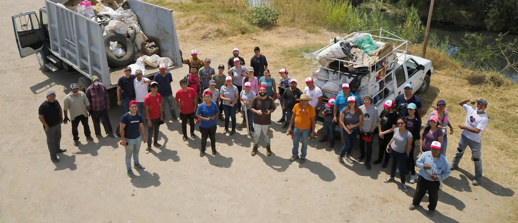 The author and local volunteers collected more than 5 tons of waste from a local river