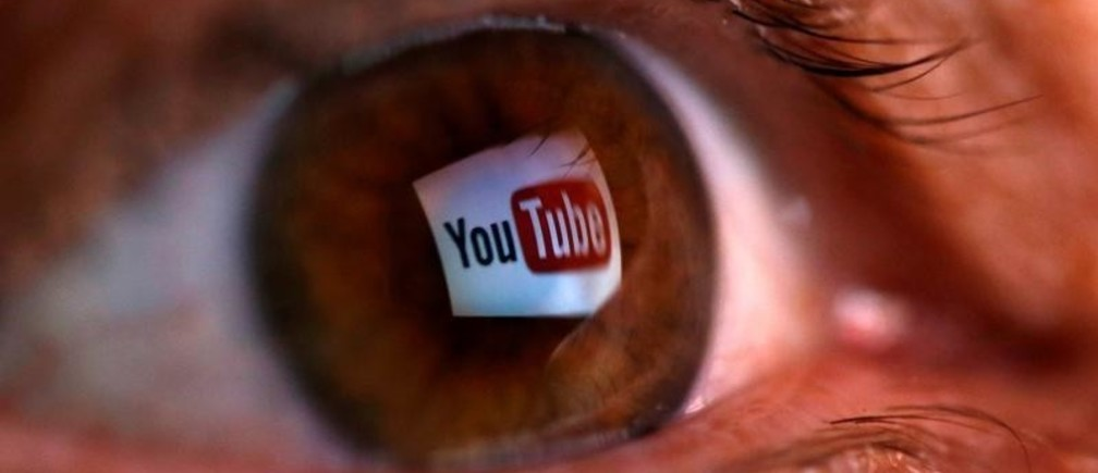 FILE PHOTO: A picture illustration shows a YouTube logo reflected in a person's eye June 18, 2014. The picture was flipped horizontally. REUTERS/Dado Ruvic/Illustration/File photo - RC1430379CA0