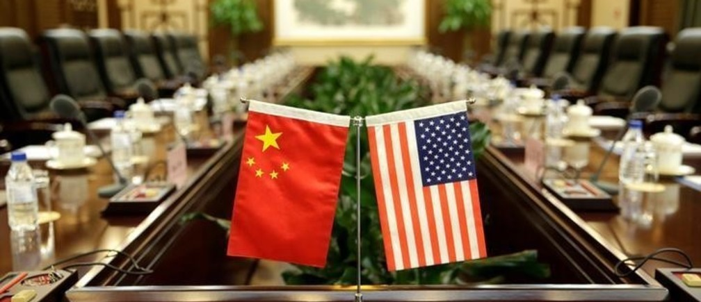 Flags of U.S. and China are placed for a meeting between Secretary of Agriculture Sonny Perdue and China's Minister of Agriculture Han Changfu at the Ministry of Agriculture in Beijing, China June 30, 2017. REUTERS/Jason Lee