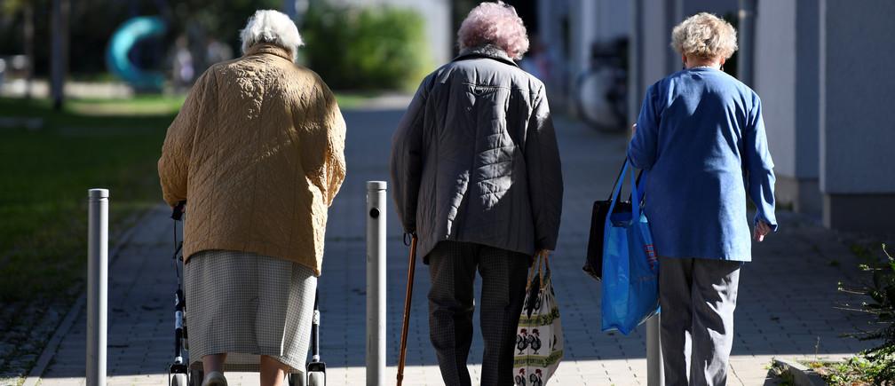 Elderly women walk on a sidewalk in the Pius quarter in Ingolstadt, Germany, October 5, 2018.