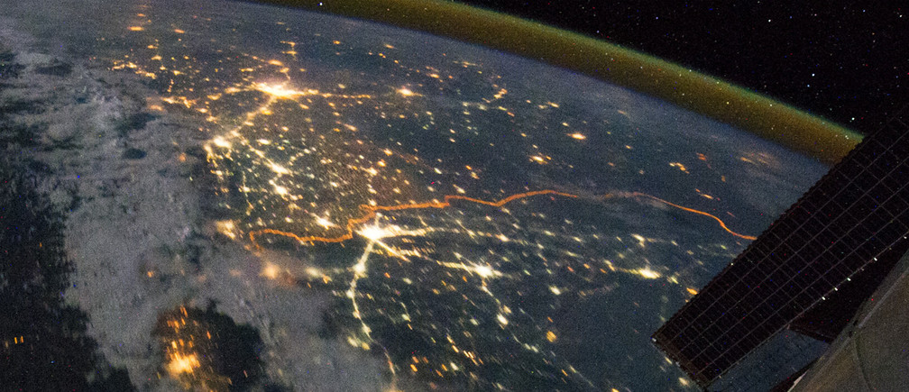 The India-Pakistan border appears as an orange line in this photograph taken by the Expedition 28 crew on the International Space Station (ISS)