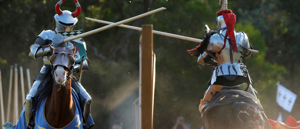 Norwegian jouster Per Estein Prois-Rohjell (L) competes with Australian jouster Phillip Leitch during the inaugural World Jousting Championship at the St Ives Medieval Faire in Sydney, Australia, September 24, 2017. REUTERS/Jason Reed - RC1973B59610