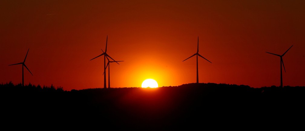 Power-generating windmill turbines are pictured during sunset at a wind park in Campeneac, France, September 3, 2019