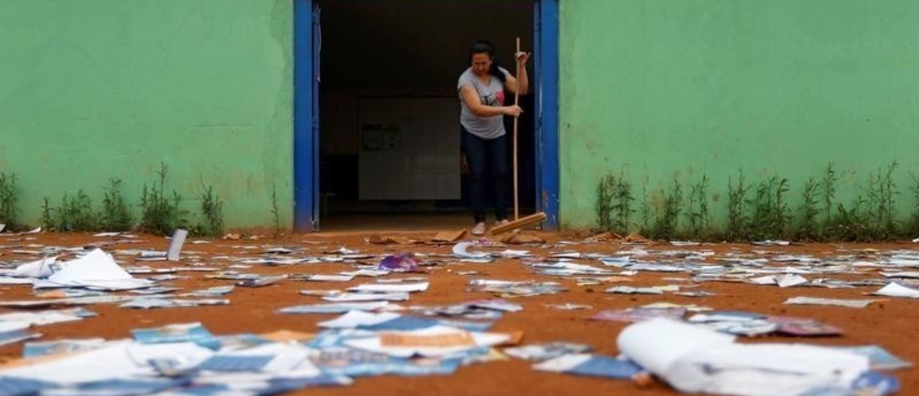 A woman sweeps the floor at a polling station during the presidential election, in the Ceilandia neighbourhood in Brasilia, Brazil October 7, 2018.