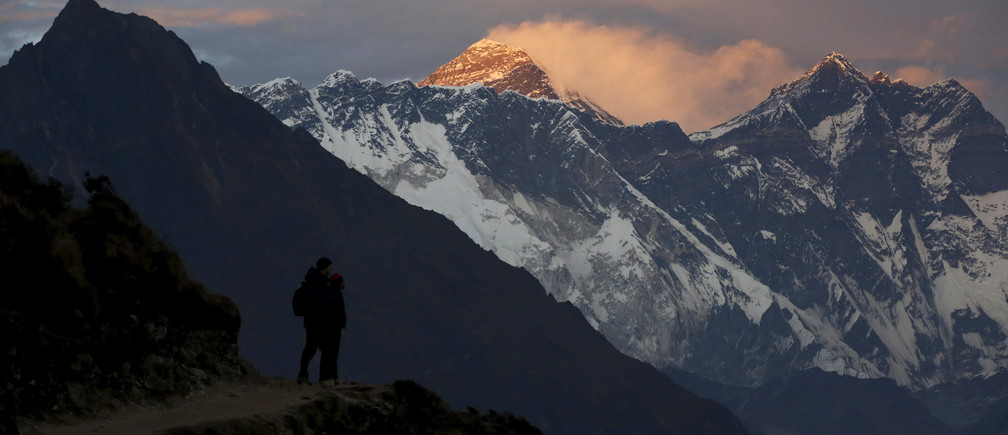 Light illuminates Mount Everest (C) during sunset in Solukhumbu district, also known as the Everest region, in this picture taken November 30, 2015. To match Insight QUAKE-NEPAL/SHERPAS      REUTERS/Navesh Chitrakar - GF10000266324