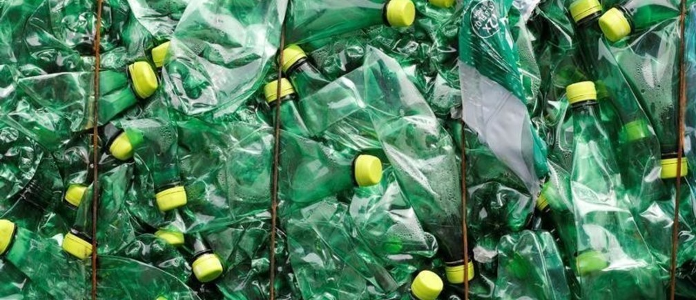 A bundle of pressed bottles made from PET (polyethylene terephthalate) plastic is stored at Poly Recycling AG company in Bilten, Switzerland April 3, 2019. REUTERS/Arnd Wiegmann - RC18BC780C60