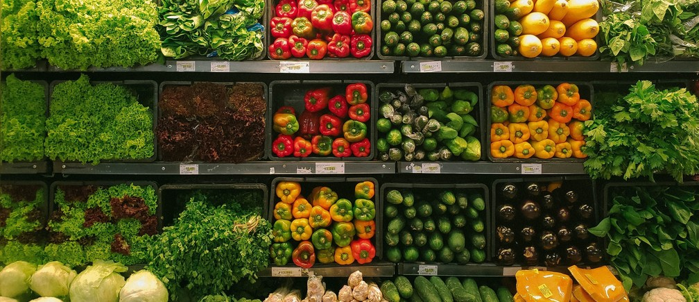 Blockchains and supply chains: a supermarket display of fruit and veg.