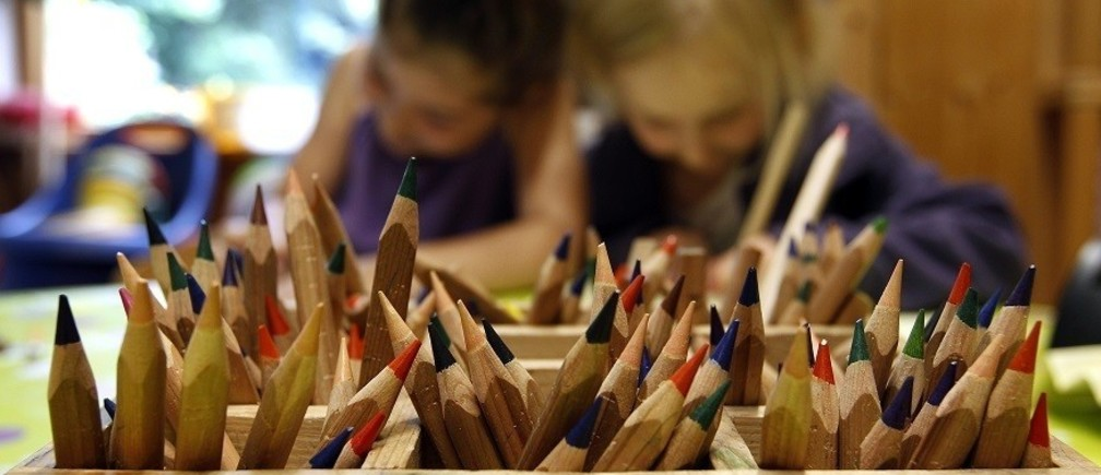 Coloured pencils are pictured in a wooden box at a nursery school in Eichenau near Munich June 18, 2012.   REUTERS/Michaela Rehle (GERMANY  - Tags: EDUCATION SOCIETY) - RTR33VKH