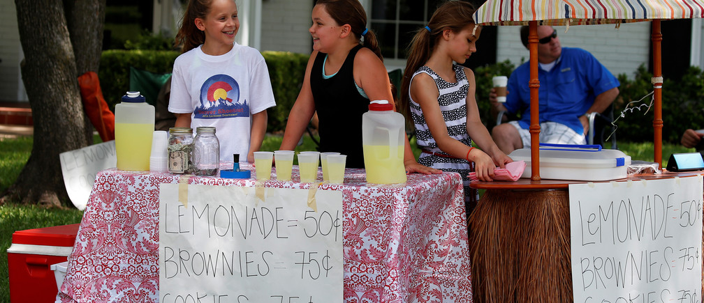 Children in Dallas operate a charity lemonade stand.