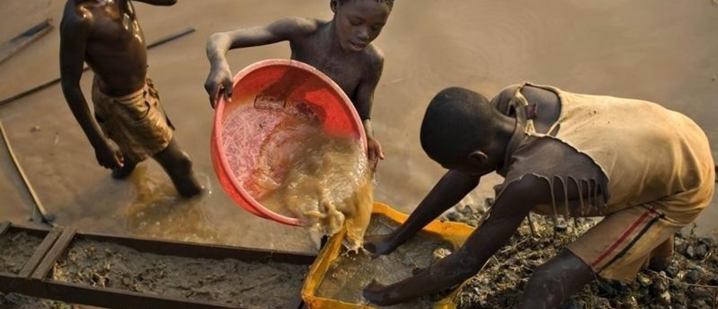 Boys pan for gold on a riverside at Iga Barriere, 25 km (15 miles) from Bunia, in the resource-rich Ituri region of eastern Congo