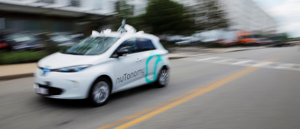 A self-driving car being developed by nuTonomy, a company creating software for autonomous vehicles, is guided down a street near their offices in Boston, Massachusetts, U.S., June 2, 2017.   REUTERS/Brian Snyder - RTX38R84