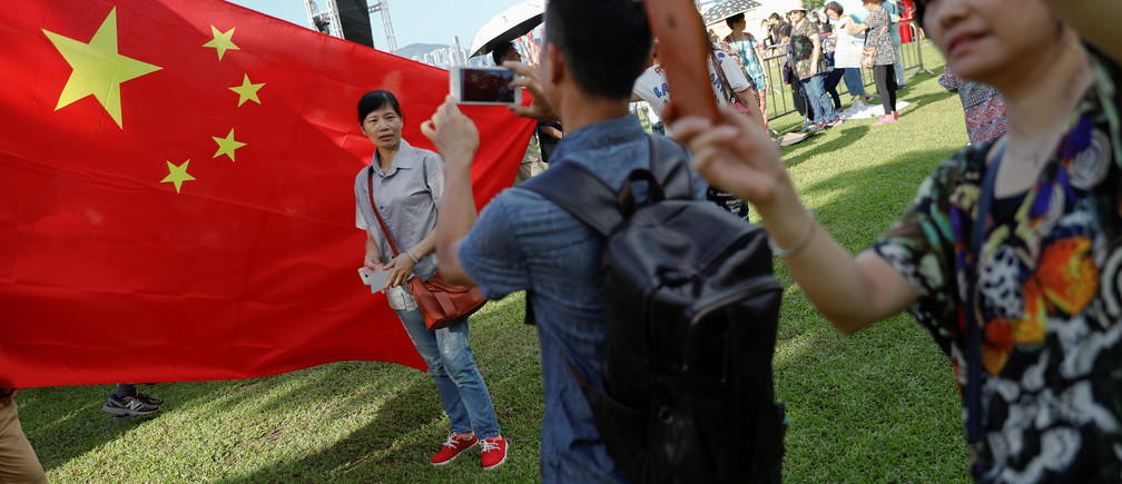 People take pictures of themselves as pro-China supporters gather during celebration marking the 20th anniversary of city's handover from British to Chinese rule, in Hong Kong, China June 29, 2017.   REUTERS/Damir Sagolj - RTS193L3