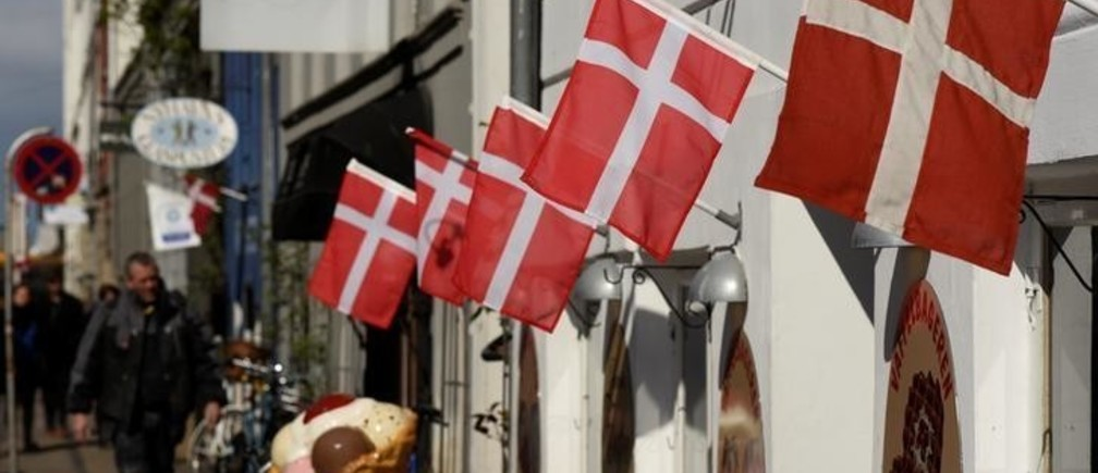 Danish flags are pictured outside a cafe at the famous landmark Nyhavn in Copenhagen, Denmark April 18, 2017.  REUTERS/Fabian Bimmer