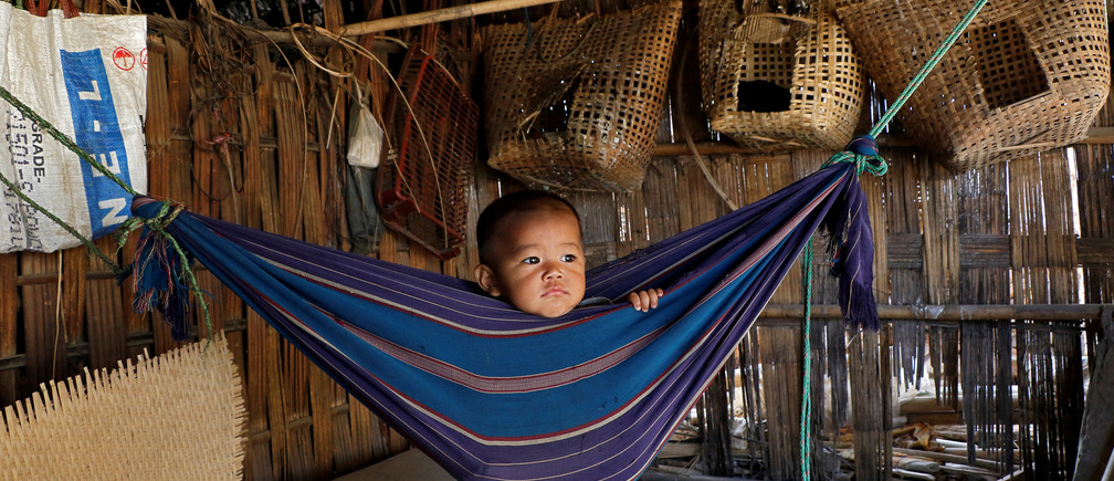 Tina Chakma, a six-month-old baby girl plays in an improvised hammock inside her parents' house on the outskirts of Agartala, India, March 20, 2018. REUTERS/Jayanta Dey     TPX IMAGES OF THE DAY - RC16F46A4C00