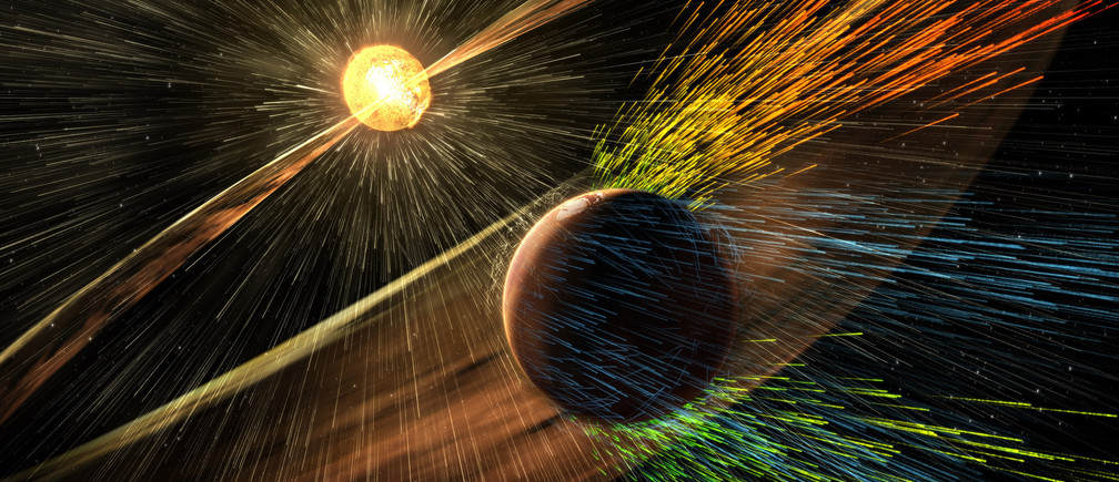 An undated artist's rendering depicts a solar storm hitting Mars and stripping ions from the planet's upper atmosphere in this NASA handout released November 5, 2015.