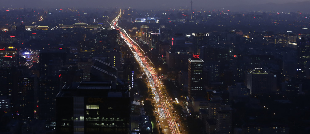 Vehicles are seen on a main avenue during the evening rush hour at sunset in Beijing September 3, 2014.