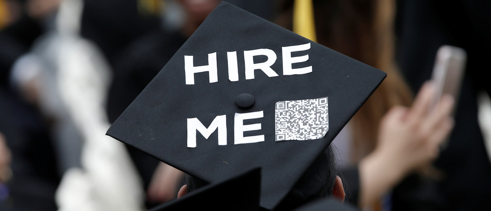 A graduating student of the City College of New York wears a message on his cap during the College's commencement ceremony in the Harlem section of Manhattan, New York, U.S., June 3, 2016. REUTERS/Mike Segar - RTX2FKQ8
