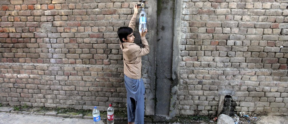 "A boy fills plastic bottles with drinking water from a tap on the outskirts of Islamabad, Pakistan February 22, 2016. Some 650 million people, or one in 10 of the world's population, have no access to safe water, putting them at risk of infectious diseases and premature death. Dirty water and poor sanitation can cause severe diarrhoeal diseases in children, killing 900 under-five a day across the world, according to United Nations estimates. World Water Day, marked this year on March 22, highlights various concerns about the world's water resources, and in 2016 is focusing on how good access to safe water can create paid work and contribute to a greener economy.  REUTERS/Faisal Mahmood  SEARCH ""SAFE WATER"" FOR THIS STORY. SEARCH ""THE WIDER IMAGE"" FOR ALL STORIES  - GF10000346390"