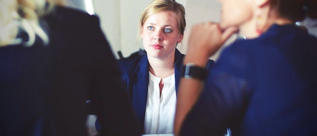 A woman in a meeting.