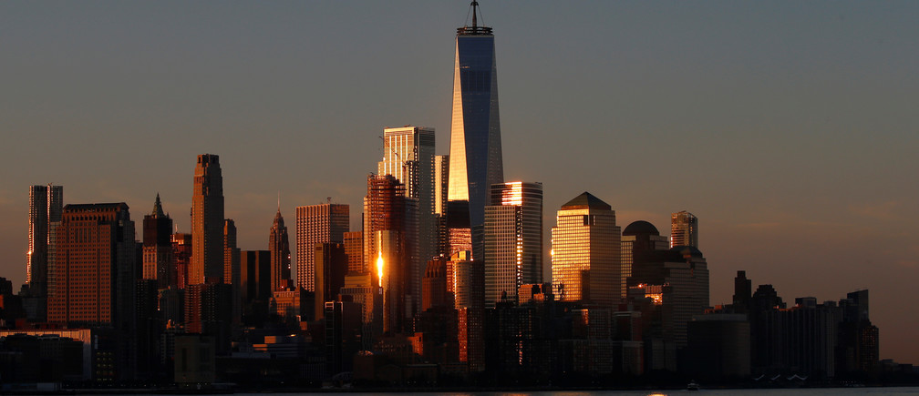 A view of the One World Trade Centre tower and the lower Manhattan skyline of New York City at sunrise as seen from Hoboken, New Jersey, U.S., August 9, 2017. REUTERS/Mike Segar - RC1365ADC640