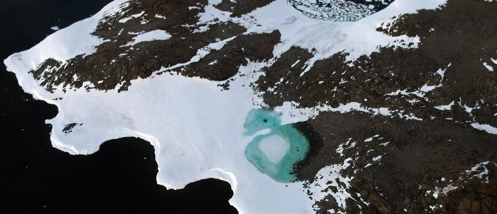 A turquoise lake (C) forms from melting snow near Cape Folger on the Budd Coast in the Australian Antarctic Territory, January 11, 2008. Australia's CSIRO's atmospheric research unit has found the world is warming faster than predicted by the United Nations' top climate change body, with harmful emissions exceeding worst-case estimates. Picture taken January 11, 2008. REUTERS/Torsten Blackwood/Pool (ANTARCTICA) - GM1DXGHASHAA