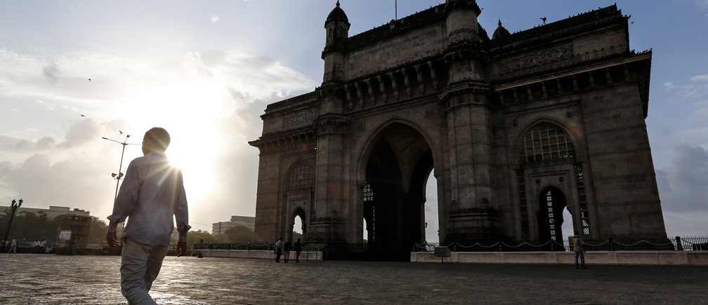 People visit Gateway of India along the Arabian sea in Mumbai, India, August 22, 2016. REUTERS/Danish Siddiqui - RC1935F45290