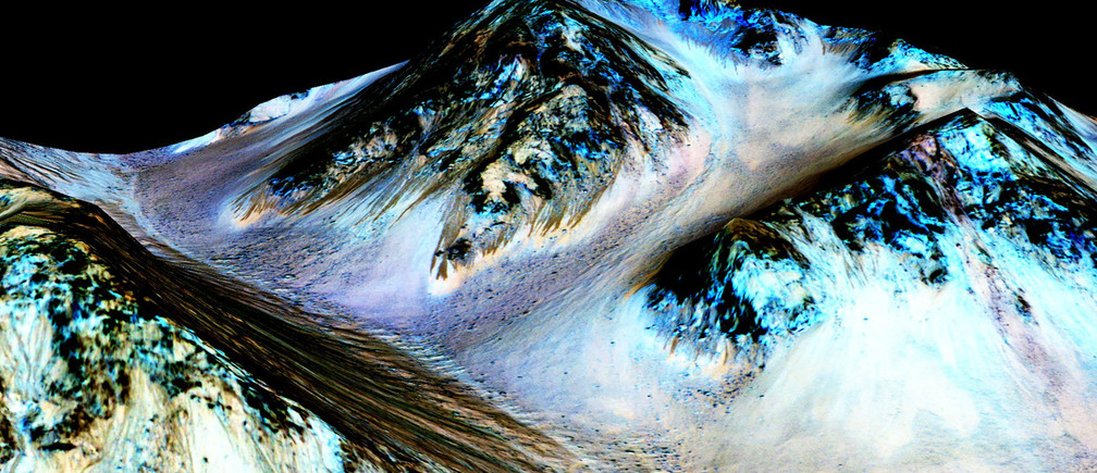 Dark, narrow, 100 meter-long streaks on Mars inferred to have been formed by contemporary flowing water are seen in an image produced by NASA, the Jet Propulsion Laboratory (JPL) and the University of Arizona. Scientists have found the first evidence that briny water may flow on the surface of Mars during the planet's summer months, a paper published on Monday showed.  NASA/JPL/University of Arizona/Handout  THIS IMAGE HAS BEEN SUPPLIED BY A THIRD PARTY. IT IS DISTRIBUTED, EXACTLY AS RECEIVED BY REUTERS, AS A SERVICE TO CLIENTS. FOR EDITORIAL USE ONLY. NOT FOR SALE FOR MARKETING OR ADVERTISING CAMPAIGNS - TM3EB9S0X1U01