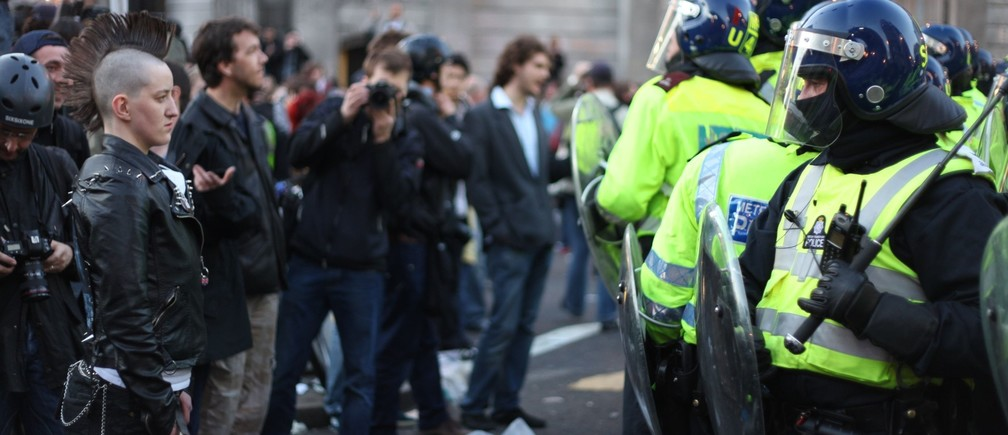 Protestors stand off against police in London, England.