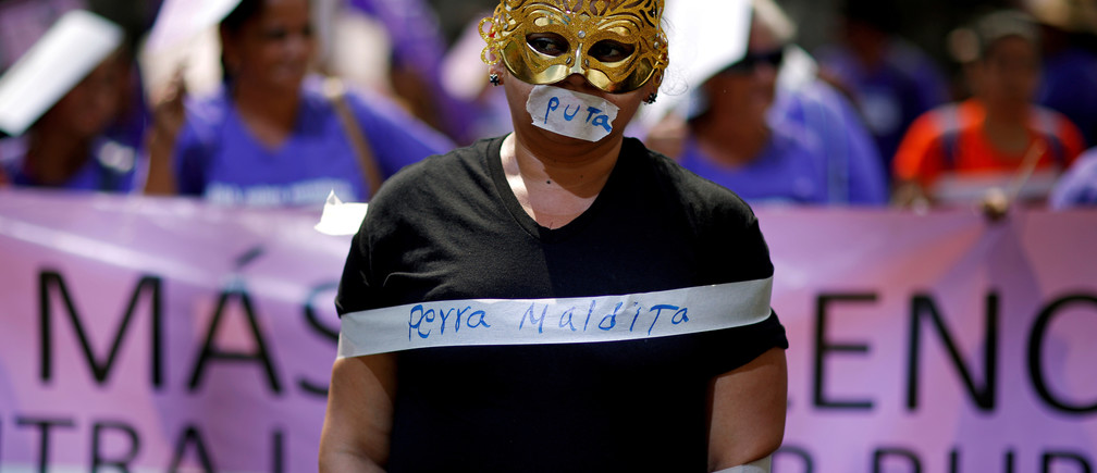 A woman participates in a protest to commemorate the U.N. International Day for the Elimination of Violence Against Women at the Attorney General's Office in San Salvador, El Salvador November 26, 2018. REUTERS/Jose Cabezas TEMPLATE OUT     TPX IMAGES OF THE DAY - RC140CDCE100