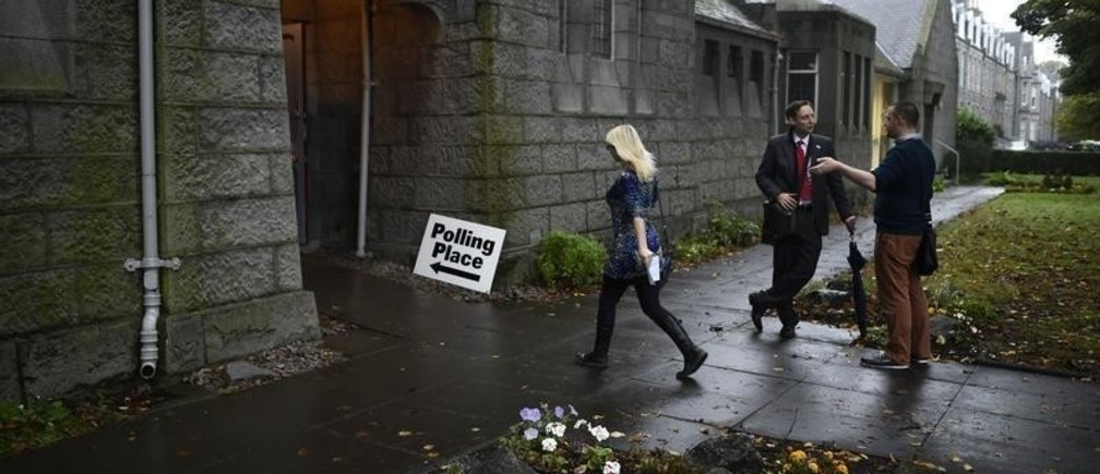 A voter arrives to cast her ballot at the Queen's Cross parish church in Aberdeen, Scotland, September 18, 2014. Polling in the referendum on Scottish independence is taking place on Thursday as Scotland votes whether or not to end the 307-year-old union with the rest of the United Kingdom. REUTERS/Dylan Martinez