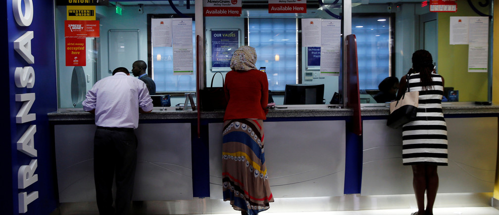 Customers make transactions inside a Chase Bank branch, now managed by Kenya Commercial Bank (KCB), after its reopening in in Kenya's capital Nairobi, April 27, 2016.