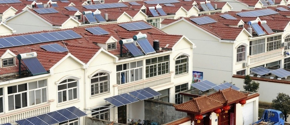 Solar panels are seen on the roofs of residential houses in Qingnan village of Lianyungang, Jiangsu province January 8, 2014. Beijing's goal of tripling solar power from small-scale operations such as rooftop panels looks overly ambitious, risking disappointment for investors who have bid up shares in Chinese solar panel makers in the past year. China has a target of installing 14.5 gigawatts (GW) of solar generating capacity this year - close to Finland's entire power capacity. But unless China promises bigger subsidies and financing support, and streamlines the process of acquiring rooftop rights, companies say the rooftop installations just aren't worth it.