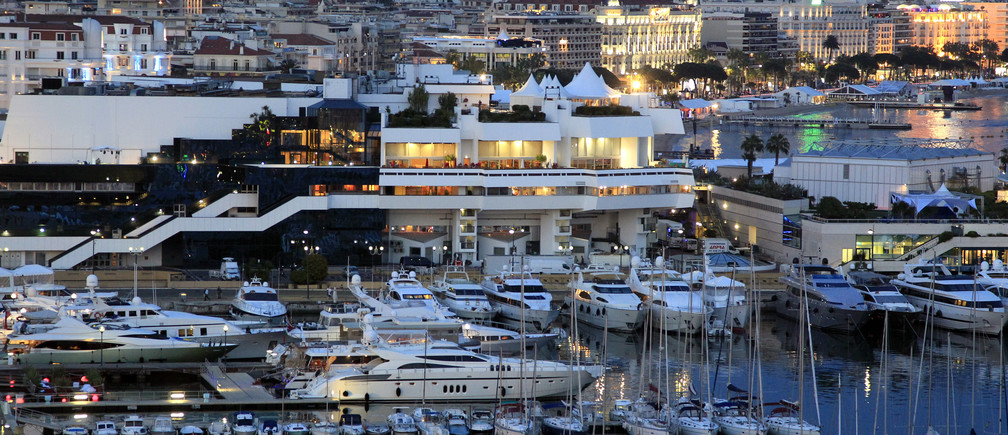 A general view shows the Festival Palace and boats moored in the harbour of Cannes, before the start of the 64th Cannes Film Festival in Cannes May 9, 2011.