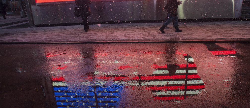 People make their way through snow in New York's Times Square, February 8, 2013.