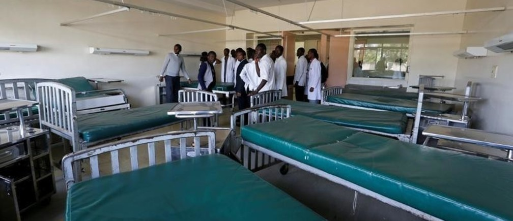 Kenyan student doctors gather inside a deserted labour ward at the Kenyatta National Hospital during a doctors' strike to demand fulfilment of a 2013 agreement between doctors' union and the government that would raise the medical practitioners pay and improve working conditions in Nairobi, Kenya, January 19, 2017. REUTERS/Thomas Mukoya - RC1991033FB0