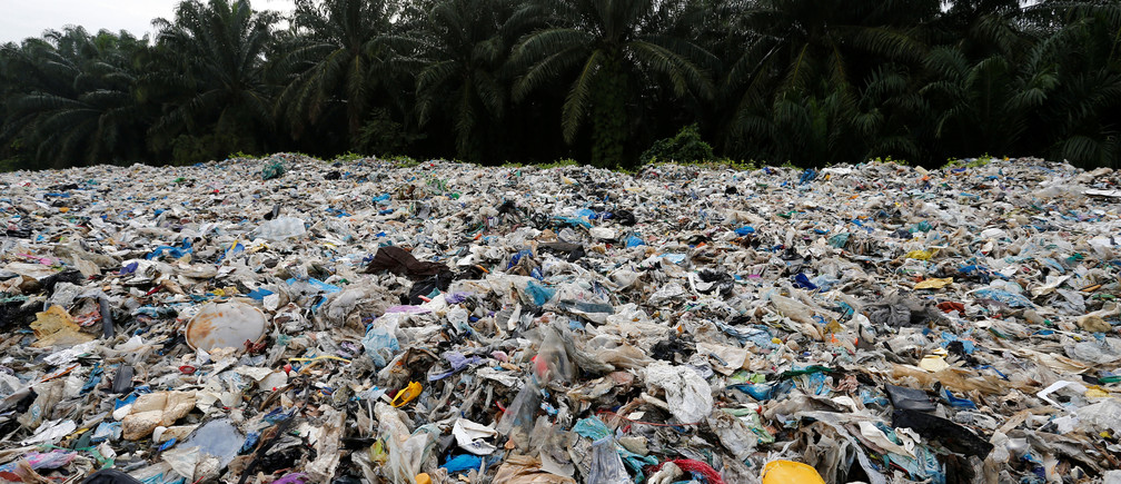 Plastic waste are piled outside an illegal recycling factory in Jenjarom, Kuala Langat, Malaysia October 14, 2018. Picture taken October 14, 2018. REUTERS/Lai Seng Sin - RC1B493C6440