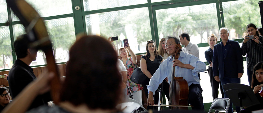 culture music cellist Yo-yo Ma plays with Mexican music students before his presentation near the Americas International Bridge to highlight what unites American and Mexican cultures, in Nuevo Laredo, Mexico April 13, 2019. REUTERS/Daniel Becerril - RC14EED2BB50