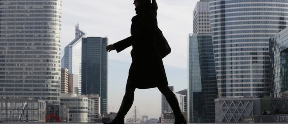 A Businesswoman is silhouetted as she makes her way under the Arche de la Defense, in the financial district west of Paris, November 20, 2012. France said its economy was sound and reforms were on track after credit ratings agency Moody's stripped it of the prized triple-A badge due to an uncertain fiscal and economic outlook. Monday's downgrade, which follows a cut by Standard & Poor's in January, was expected but is a blow to Socialist President Francois Hollande as he tries to fix France's finances and revive the euro zone's second largest economy.
